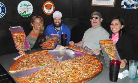 Absolutely ridiculous ginormous pizza. With all the toppings, of course.