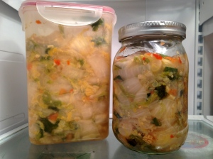 5 lbs of cabbage crammed into two jars. Beautiful!